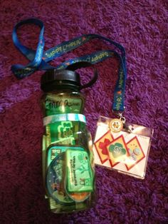 way to present badges to girls - posted by Amanda Taylor Chastain on the GS Idea Sharing FB page. fun patches in bottle, earned badges in name badge lanyard. Good way to also encourage girls to use reusable water bottle too.
