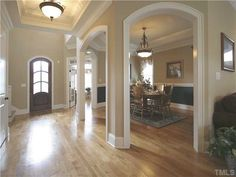 arches connect to foyer. Heavy crown molding. Trey ceiling in small foyer?n Arch facing front
