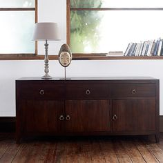 Seba Sideboard 3 Door, 3 Drawer. With its classic design and rich dark brown stain, which emphasises the beautiful natural grain of the wood, our Seba sideboard is a functional addition to your home. Handmade from solid teak in Indonesia by the most skilled of artisans this practical design, with its Eastern inspired finish, is perfect for your living room or bedroom.