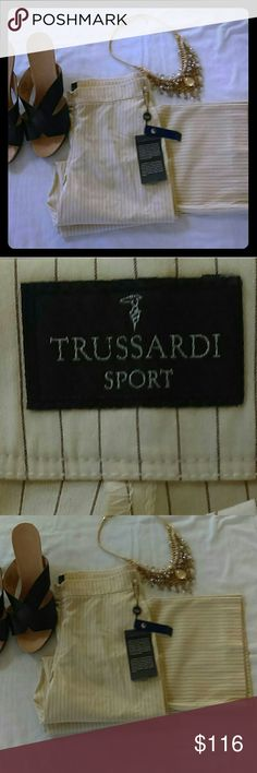 TRUSSARDI Sport pinstripe pants BNWT For over 100 Trussardi has been the expression of its Milanese identity and made Italian style popular throughout the world. Its strong roots and craftsmanship are consistently updated to produce beautiful items that belong in your closet. Contemporary luxury inspired by the dynamic Metropolitan setting around them.   Elegant cream pinstripe pants.  Size 42 Italy is a US size 6.  Viscose, nylon, elastin, and acetate.  Straight leg. Trussardi Pants…