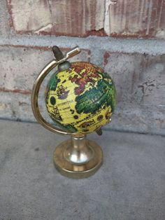 Check out this item in my Etsy shop https://www.etsy.com/listing/228452005/vintage-old-world-globe-small-desk