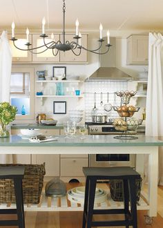 so pretty ... Love the light fixture, the tiered metal baskets and the shelving