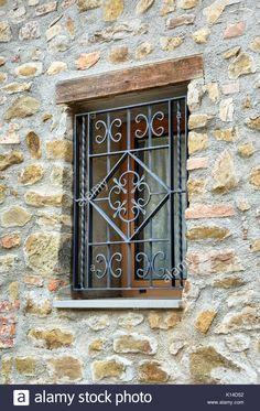window with iron grating on stone wall Stock Photo, Royalty Free Image: 155606110 - Alamy Steel Gate Design, Iron Gate Design, House Gate Design, Door Design, Window Grill Design Modern, Burglar Bars, Balcony Railing Design, Iron Balcony, Photo Window