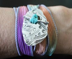"""Silk Wrap Bracelet ~ This funky two-part toggle wrap is called the """"Lava Lamp,"""" like your old retro lava lamp.  This pure silver toggle, made from recycled silver, is interlaced with a lava lamp-colored hand dyed silk ribbon, with hues of purple of and orange, that wraps end over end around your wrist.  The gentle sari textile wrap is generous, and flowing in grace and comfort.  The finely crafted artisan toggle is crafted from pure, fine, enviro-friendly, silver and is 99% pure."""