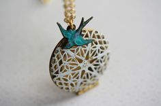 White Filigree Locket and the Lingering Blue Bird Necklace