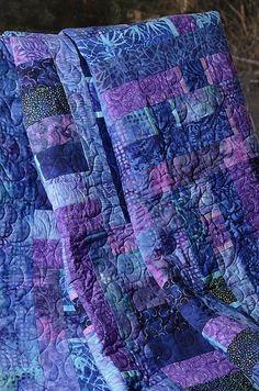 beautiful quilt in purples.