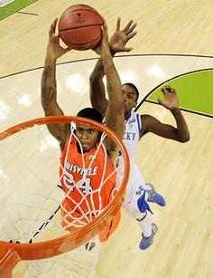 Louisville forward Chane Behanan (24) goes up for a dunk against Kentucky..       Chris Steppig - US Presswire
