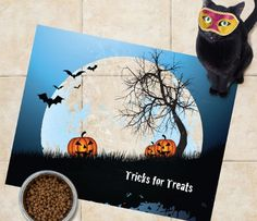 Sniff It Out Designer Trick or Treat Dog or Cat Food Mat. This mat will prevent messes while it gets you and your pet in the Halloween spirit. Who knows more about tricks and treats than your furry friend?