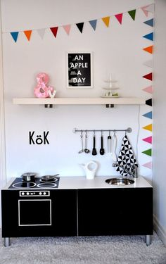 IKEA Hack - BESTÅ unit turned into a mini play kitchen.