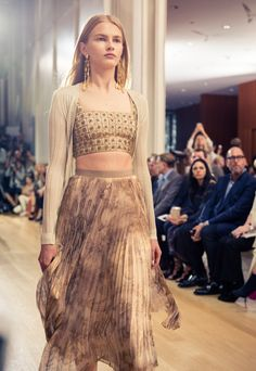 Oscar de la Renta's Spring 2017 Collection: bejeweled crop top and beige floral pleated skirt with tan cardigan   coveteur.com