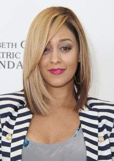 Tia Mowry-this is more the style i would like to move to, although i don't know if my ultra thin hair will support this look, without wimping out, and looking oily to quickly (happens WAY to easily with my hair!)