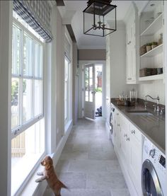Love floor, countertop and light Mudroom Laundry Room Combined. Great mudroom laundry room design featuring quartz countertop and natural stone floor tiles. Lighting is Honore Lantern by Suzanne Kasler in Antique Zinc. Hayburn & Co House Design, House, Home, Luxury Homes, New Homes, House Interior, Luxury Interior Design, Mudroom Laundry Room, Laundry Room