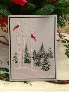 Impression Obsession Birch trees with cardinals and IO pine trees.