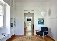 Architecture studio Vokes and Peters has created a new timber-panelled interior for a heritage property in Queensland, Australia, and built a new cottage-like extension at the rear