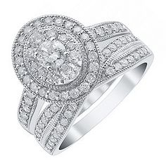 This stunning bridal set combines classic components with a contemporary design. The 18ct white gold engagement ring features stunning diamonds in a halo setting, finished with diamond set shoulders and a hidden diamond in a rose gold rose setting. With a matching crossover wedding band, this set offers timeless sparkle with a total 1ct of diamonds.