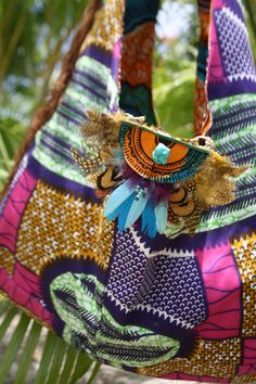 authentic tribal bag with fashion sense, responsibly made in cooperation between Kuna indians, a panamanian designer, an american organizational genius and a group of women of indigenous mix who raise their families cooperatively on an organic farm in the mountains of Panama...what? yep, global mash!