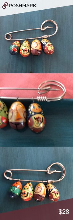 Handpainted Russian Nesting Doll Brooch Incredible pin with meticulously hand painted Russian nesting doll charms. Lovely and amazingly detailed. Each tiny doll is different! Please see photos for size. Jewelry Brooches