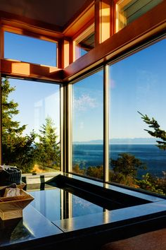"""Prentiss Architects created this contemporary home in 2010 for a couple on San Juan Island, Washington, USA. It consists of two structures, one of which contains work spaces and a garage while the other hosts the primary living areas. San Juan Cliffside by Prentiss Architects: """"The project site is located on a forested ridge on San Juan Island. The steep topography created both design and construction challenges. The project is divided into two structures. The smaller structure hous..."""