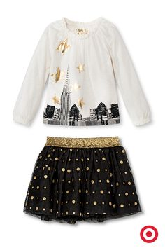 Your little girl will celebrate in style with these on-trend, metallic-embellished pieces by Genuine Kids from Oshkosh. The Skyline Tee features a cityscape with shiny gold stars, and the coordinating Polka Dot Mini Skirt is adorned with delightful gold glitter. Black and gold—a luxe color combo for all ages.