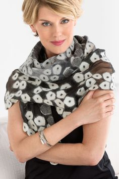 Alana Wrap by Elizabeth Rubidge. Merino wool blossoms are nuno-felted onto sheer silk organza, creating a sumptuous, lightweight scarf full of rich textural detail. Hints of organza peek through the felt, adding even more depth to the design. Overview: Pointed ends Artist-made in the U.S.A. Fabric & Care: wool / silk Dry clean Dimensions: 80