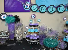 Teal and Purple Zebra Birthday Party Theme. Love the blocks of color on the wall and zebra cakes in jar. Lots of ideas. Pretty Printouts too.  from letsPARTYon on Etsy - http://www.etsy.com/people/letsPARTYon