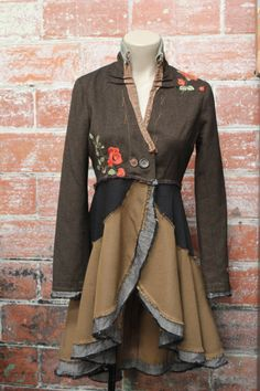 GhEttO GoLdiLocKs is the clothing line created by Briget Campbell. She has found a passion for reconstructed old and unwanted clothes into fresh new wearable fashion.  Cutting, sewing and patching fabric together has become this unique and one of a kind handmade clothing line.   Briget believes in creating less waste in the world and using the overabundance of garments already available to her for her clothing line.