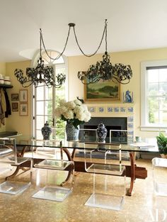 BNOdesign Lucite chairs from NIBA Home surround the custom-made breakfast table.