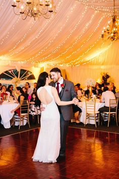 Great look at the bride's keyhole wedding dress. The twinkle lights and chandeliers are so pretty here. Red, White, and Gold: A Pretty Bicultural Wedding | Stonegate Conference and Banquet Centre | Jordan Imhoff Photography