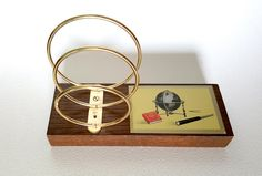 Mid Century Modern Atomic Letter Holder Sorter | Brass and Wood | Mid Mod Retro Desk Accessory | Vintage Travel Themed Desk Set Paper Sorter by TheRetroProfessor on Etsy https://www.etsy.com/listing/277960698/mid-century-modern-atomic-letter-holder