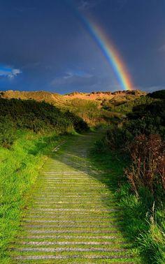 Chasing rainbows at Balmedie Beach in Scotland