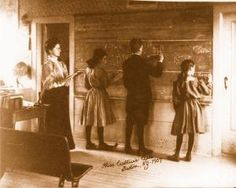 Miss Crabtree's Class 1907. Notice that the three students are writing on the wall.