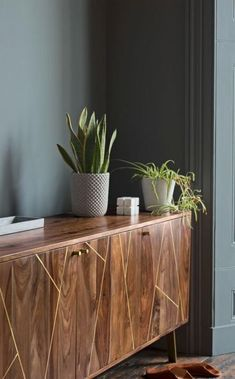 The Herning sideboard in rosewood and brass. The simple shape of the Herning helps show off its brass detailing, creating a retro sideboard with striking appeal. A perfect storage solution for the living room, hallway or dining room.