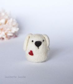 * This is a made to order creation. As it is a handmade item each is unique and may differ a little from the photos. A cute needle felted wool dog with a heart. This little white dog is made of sheep wool. The dog is about 2.5 inches / 4.3cm tall from bottom to the top of its ears, and is 1.3 inches 3.3cm wide. This soft sculpture dog is a wonderful whimsical gift to show you care. If you are a dog lover a super cute treat for yourself. As it is an original handmade creation and due to m...