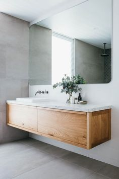 This gorgeous custom floating timber vanity made f .This gorgeous custom floating timber vanity made f . - Custom Floating Gorgeous mirror timber Luxurious Coastal Home: Kyal and Long Ensuite Bathrooms, Laundry In Bathroom, Bathroom Inspo, Bathroom Renovations, Bathroom Interior, Bathroom Storage, Bathroom Inspiration, Bathroom Grey, Vanity Bathroom