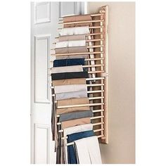 """Your pants can look as good as new, using Wooden trouser rack Space. It Keeps your pants looking their best and your closet completely organized. Simply mount this handy wooden rack on the closet wall or on the back of a door to store up to 20 pairs of pants neatly and efficiently. Each dowel swings out 180 degrees for easy hanging and removal. Also makes a great tie rack. Rack measures 17"""" W x 2.25"""" D x 40"""" H overall. Item is in hand, ready to ship next day!"""