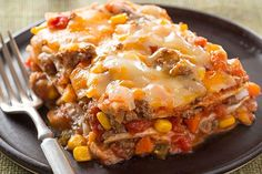 Ground beef, salsa, refried beans and cheese are layered between tortillas for a burrito bake that's like a fiesta in a dish.