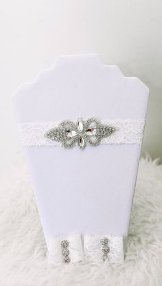 Amelia Set:  This vintage rhinestone headband and wristlet set is stunning. The headband features a gorgeous rhinestone embellishment on a lace stretchy band and the matching wristlets complete the look, making it a perfect newborn photography prop or addition to an outfit. www.petitespoupees.ca