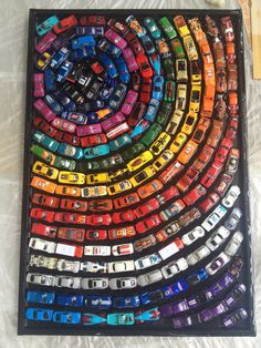 Very unique handmade toy car artwork. Made with around 300 cars.