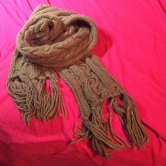 Knit scarf Taupe colored scarf.. Barely worn and in perfect condition.. About 6 ft in length Accessories Scarves & Wraps
