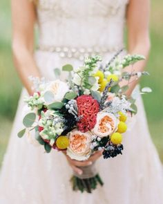 Erin carried an arrangement of garden roses, craspedia, eucalyptus, celosia, lavender, and snapdragon by Lindsey Grannis of One Fine Day Productions at her Colorado ranch wedding.
