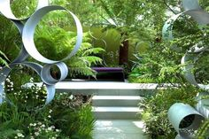 gothamgardener:    Check out these sculptural metal cylinders in a garden designed by Andy Sturgeon.