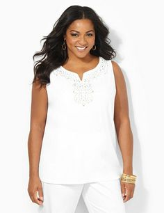 We love our new, stretch cotton tank underneath any of our lightweight cardigans or shrugs. Metallic rhinestuds accent the notch neckline for a twinkling glow. Side slits at the hem. Catherines tops are designed for the plus size woman to guarantee a flattering fit. catherines.com