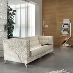 Luxury-sofa-in-Hollywood-style - It is luxury and made of quality white leather in a very authentic 60s design style with unique elements.