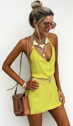Bright yellow dress & silver jewelry.