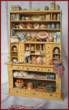 Kitchen hutch filled with miniature goodies. What a treasure hunt!