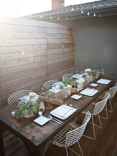 Create your own Scandinavian-inspired centerpiece by collecting and displaying raw wood elements, simple pots filled with succulents, and bud vases with white flowers. Keep the color scheme limited to natural earth tones to enhance eco-friendly organic textures./