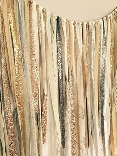 Make an easy wedding photo booth backdrop with metallic sequined fabric.