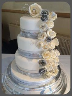 Silver and ivory rose cascade wedding cake