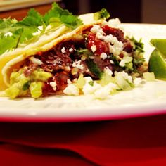 This is a great recipe for authentic Mexican taqueria style carne asada tacos (beef tacos). These are served on the soft corn tortillas, unlike the American version of tacos.