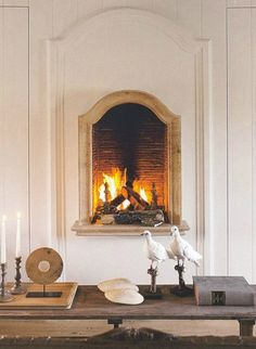 I like this height for a fireplace, actually. You could really get your cold derrière in front of it.